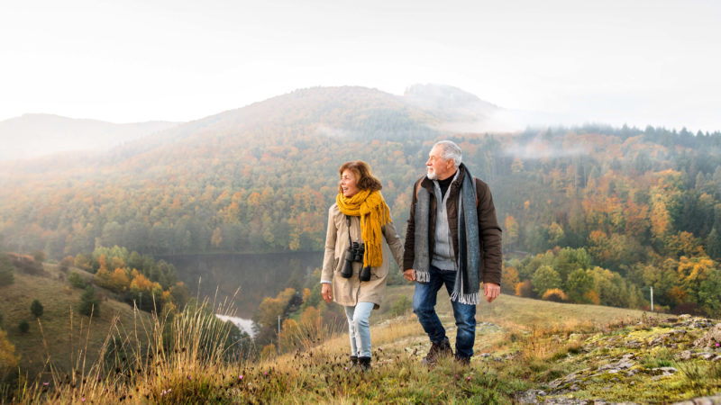 Elder Couple Hiking Mountain Fall Season