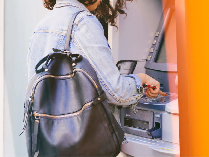 Female Backpack ATM Machine With Her Debit Card